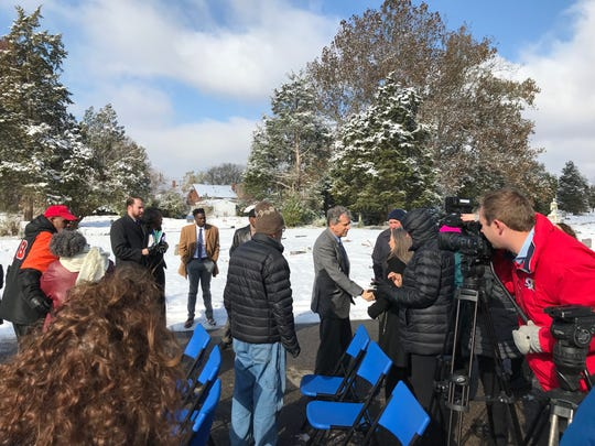 U.S. Sen. Sherrod Brown, center, city and county officials as well as representatives of Union Baptist Cemetery and the National Underground Railroad Freedom Center at a press conference at the cemetery Tuesday.