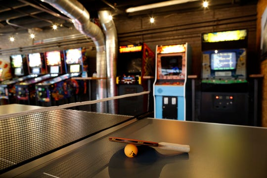 The gaming space upstairs at the new BrewDog Brewery location in the Pendleton neighborhood of Cincinnati on Tuesday, Nov. 12, 2019. The new BrewDog location features two levels, plus a rooftop bar, space with room for games, education, dining and events.