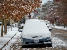 Snow-covered cars sit along Sharon Road in Glendale on Tuesday, Nov. 12, 2019.  Monday night brought the regions first measurable snowfall of the year.