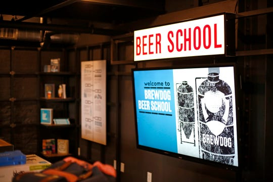 The Beer School area at the new BrewDog Brewery location in the Pendleton neighborhood of Cincinnati on Tuesday, Nov. 12, 2019. The new BrewDog location features two levels, plus a rooftop bar, space with room for games, education, dining and events.