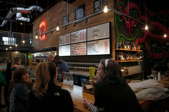 The main bar at the new BrewDog Brewery location in the Pendleton neighborhood of Cincinnati on Tuesday, Nov. 12, 2019. The new BrewDog location features two levels, plus a rooftop bar, space with room for games, education, dining and events.