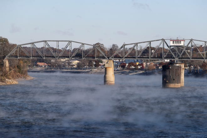Steam rising from the river wasps around over the surface and underneath the R J Corman Bridge along the Cumberland River in Clarksville, Tenn., on Tuesday, Nov. 12, 2019. | henrytaylor@theleafchronicle.com