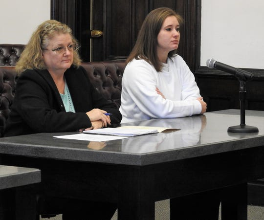 Attorney Marie Seiber with client Samantha J. Romine Tuesday in Coshocton County Common Pleas Court. Romine received three years mandatory in prison for trafficking in methamphetamine, a second-degree felony.