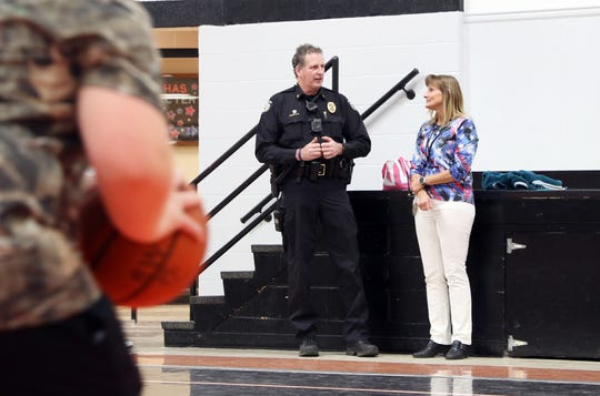 Chief Stephen Klopfenstein talks with Danielle Bradford during an indoor recess at Ridgewood Middle School. Klopfenstein is the school resource officer for Ridgewood Local Schools.