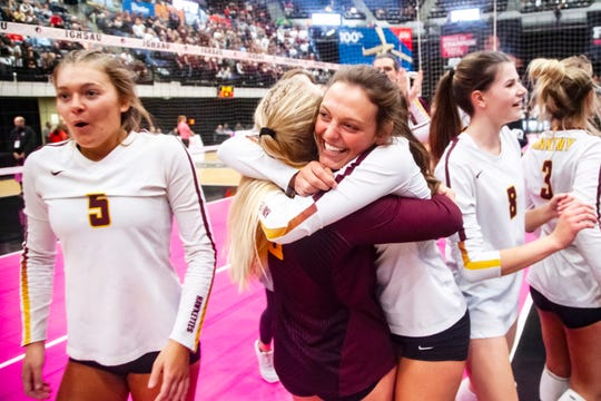 Ankeny Hawkettes celebrate after a Class 5A high school volleyball state tournament quarterfinal match, Tuesday, Nov., 12, 2019, at the U.S. Cellular Center in Cedar Rapids, Iowa.