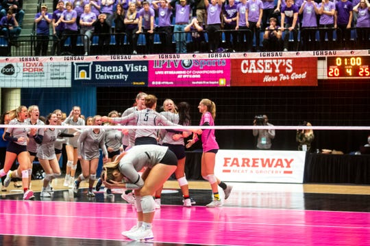 Pleasant Valley players celebrate after winning as Liberty's Rylee Fay reacts during a Class 5A high school volleyball state tournament quarterfinal match, Tuesday, Nov., 12, 2019, at the U.S. Cellular Center in Cedar Rapids, Iowa.