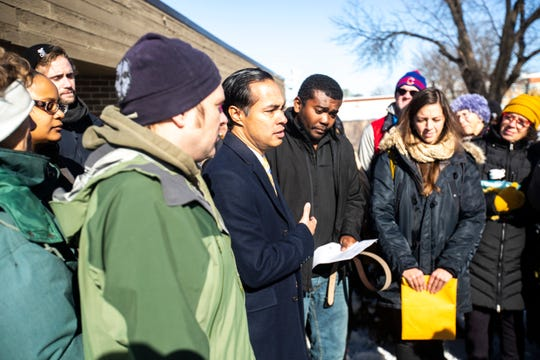 Democratic presidential candidate Julián Castro speaks to reporters with members of the Catholic Worker House of Iowa City while supporting José Reynaldo Robinson Palacios, a Honduran refugee during a scheduled check-in with ICE, Tuesday, Nov., 12, 2019, in Cedar Rapids, Iowa.