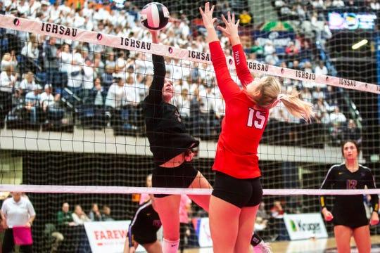 Waukee's Ellie Hemesath goes up for an attack against Cedar Falls' Katie Remmert during a Class 5A high school volleyball state tournament quarterfinal match, Tuesday, Nov., 12, 2019, at the U.S. Cellular Center in Cedar Rapids, Iowa.
