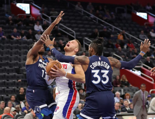 Blake Griffin drives against Robert Covington and Treveon Graham during the first quarter.