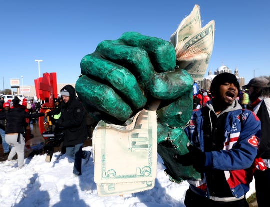 """George Haggen, 28 Detroit joined 300 others to protest McDonald's at Outer Drive and Van Dyke in Detroit on Tuesday November, 12, 2019. Haggen has five family members who work at McDonald's and said that """"they can't survive off $9.45"""" an hour.  The protesters included McDonald's workers, hospital workers, security officers and janitors."""