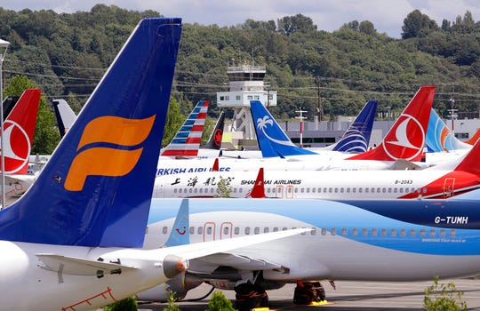 In this June 27, 2019, file photo, dozens of grounded Boeing 737 MAX airplanes crowd a parking area adjacent to Boeing Field in Seattle.