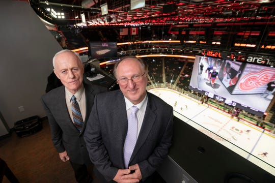 Color commentator Paul Woods, left, and play-by-play announcer Ken Kal were finishing their 25th season calling Red Wings games before the NHL season was suspended.