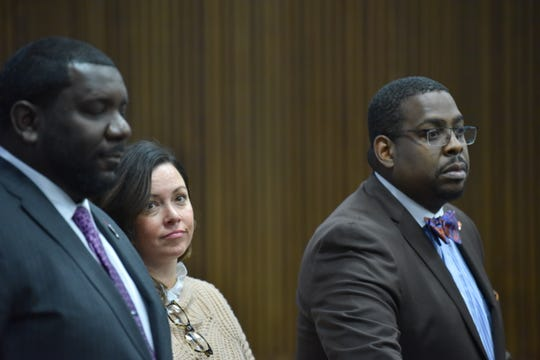 Allegheny (Pa.) County Controller Chelsea Wagner stands with co-council Kevin Mincey, left, and Charles Longstreet, II, Tuesday, Nov. 12, 2019, prior to her jury trial on two counts of resisting and obstructing Detroit police officers at the Westin Book Cadillac hotel last March.