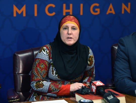 Attorney Amy V. Doukoure,who represents Ali Jaber in a complaint against a Henry Ford Community College professor accused of  Islamophobic hate speech addresses news media during a press conference at the CAIR-MI office in Farmington Hills Tuesday.