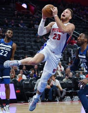 Pistons' Blake Griffin scores over Timberwolves' Robert Covington in the second quarter. Griffin had 19 points and seven rebounds.