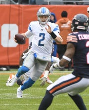 Lions quarterback Jeff Driskel scrambles out of the pocket in the third quarter Sunday against the Bears.