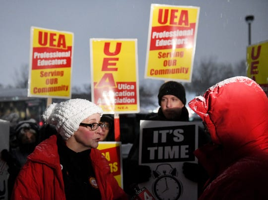 Utica Education Association president Liza Parkinson gives an interview at a Nov. 11 rally.