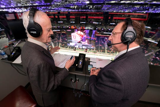 Color commentator Paul Woods, left, and play-by-play announcer Ken Kal, work in their studio above the ice before the start of a game last week at Little Caesars Arena in Detroit.