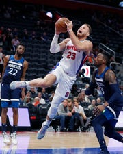 Detroit Pistons forward Blake Griffin (23) makes a layup as Minnesota Timberwolves forward Robert Covington (33) defends during the first half.