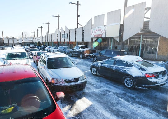 Cars arrive on a snowy Tuesday morning as job seekers fill out applications and interview at the Rubicon Capital and Pharmaco Inc. job fair for a proposed cannabis park and future shopping center in Pontiac.