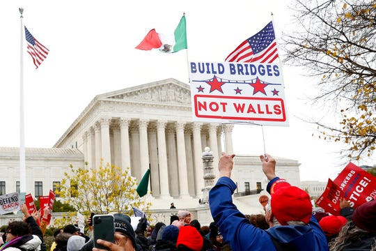 People rally outside the Supreme Court as oral arguments are heard in the case of President Trump's decision to end the Obama-era, Deferred Action for Childhood Arrivals program (DACA), Tuesday, Nov. 12, 2019, at the Supreme Court in Washington.
