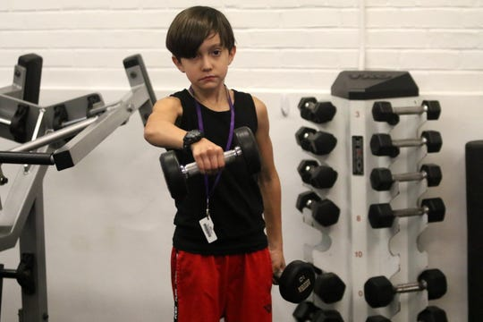 Jonah Goldwyn, 9, of Erwin works out at the Corning YMCA on Nov. 8, 2019.