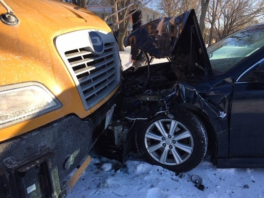Snowy and icy conditions caused a car to crash into a Johnson school bus Tuesday, Nov. 12, in the town of Beaver Dam.
