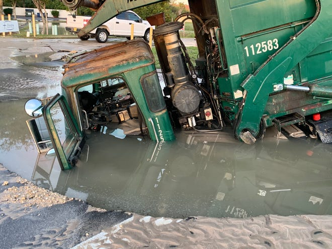 The line break, at U.S. 41 near Youngquist Road, washed away enough ground under the roadway that when a garbage truck from Advance Disposal drove over the site the roadway collapsed, sinking the truck up to the driver's seat.