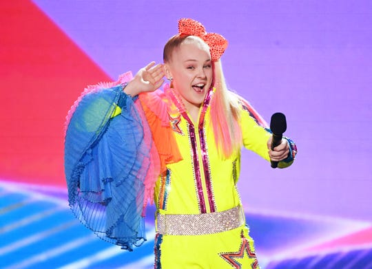 JoJo Siwa has some fun with the   crowd at Nickelodeon's 2019 Kids' Choice Awards in March.