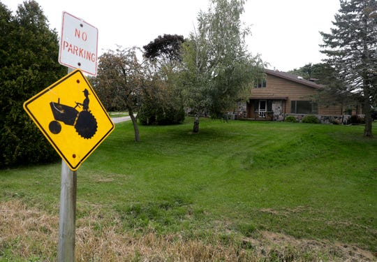 This house in rural Manitowoc County was where Ethan Hauschultz, 7, was fatally injured in 2018 while carrying out a punishment his legal guardian had assigned because the boy talked back to a teacher. The guardian, Timothy Hauschultz, is charged with murder and felony child abuse as party to a crime. Timothy's adopted son, Damian Hauschultz, is charged with first-degree reckless homicide and felony child-abuse. Prosecutors allege that Damian caused the injuries that led to Ethan's death.