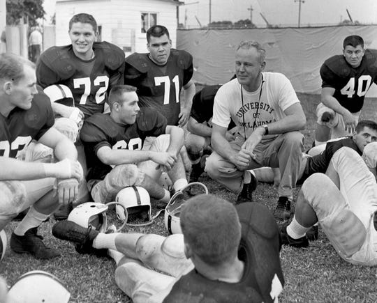 Bud Wilkinson, in tee shirt, won 145 games as a college coach, all of them at Oklahoma and all by age 50.