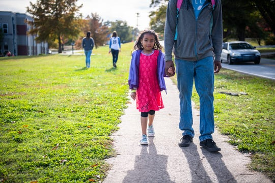 Derrick Little walks his daughter Neveah Little, 6, home from Monaview Elementary School Friday, November 8, 2019.