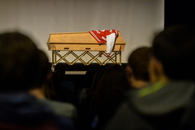 Conrad High School students attend a mock memorial service for classmate Drew Ginther as part of Conrad's Ghost Out program, which presents the dangers of drinking and driving through mock crash scenes and court proceedings.