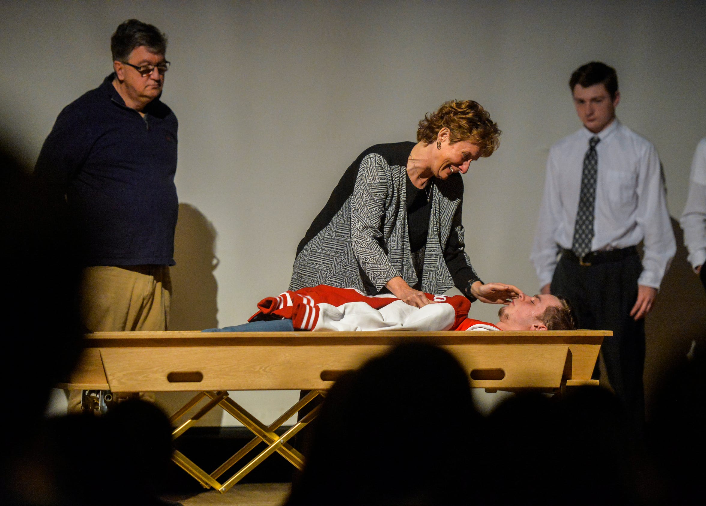 Wendy Paulsen, an actor, plays the role of Conrad student Andrew Ginther's mother at a mock memorial service as part of Conrad's Ghost Out program.  The Ghost Out program presents the dangers of drinking and driving through mock crash scenes and court proceedings.