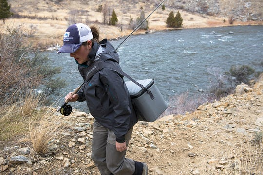 An angler hikes along the Madison River in Bear Trap Canyon in this 2015 file photo.