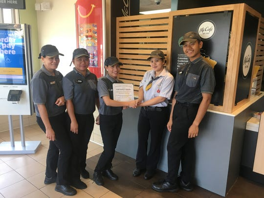 McDonald's of Guam Employee of the third quarter certificate was presented to Mary Ronilyn Monera who started her career with McDonald's of Harmon on October 24, 2019. Joining in the presentation are McDonald's employees: Carina Palanca, Sheryl Amoyo, Mary Ronilyn Monera, Maricel Maling and Dominic Quogana.