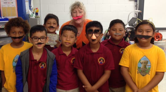 "The third-grade G.A.T.E. students of Capt. H.B. Price School supported Red Ribbon spirit week day "" I mustache you to say no to drugs"" on Oct. 29. Front row from left: Kekoa Garcia, Dante Calvo, Xavier Yano, and Anya Fernandez. Second row from left: Liam Laguana, Michael Clement III, Ms. Loughran, G.A.T.E. teacher, and Sinahi King."