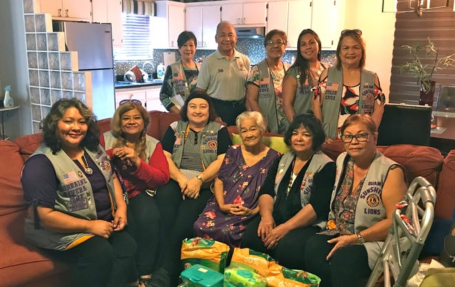 The Guam Sunshine Lions Club members visited Cecilia Cruz, 79, of Mangilao on Nov. 9, bringing supplies and a walker, song, and cheer. From left: Lions Lorraine Rivera, LouJean Borja, Doris Cruz, Cecilia Cruz, Connie Rivera, and Jill Pangelinan. Standing: Lions Marietta Camacho, Pete Babauta, Dee Cruz, Tish Tano, and Julie Cruz.