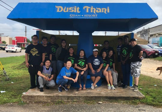 """Dusit Thani Guam Resort recently completed a bus stop beautification project in Dededo in an effort to drive environmental awareness among the community. The project was initiated by the hotel's energy and environmental group called """"Watts Up"""" committee. From October 11-13 members did general cleaning in the area surrounding the bus stop, painting and bush cutting. The bus stop is located on the corner of East Liguan Avenue and Macheche Road in Dededo. The Adopt A Bus Stop will undergo maintenance by Dusit Thani Guam Resort over the course of one year."""