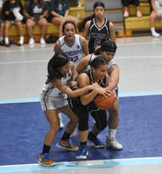 In this file photo from Nov. 12, 2019, the St. Paul Warriors took on the the Academy Cougars and beat them 62-57 in an IIAAG Girls High School Basketball game at the Academy of Our Lady of Guam Gym, Hagåtña. Both the Warriors and Cougars are the league's top seeds leaded into the single-elimination playoffs that start Dec. 7.
