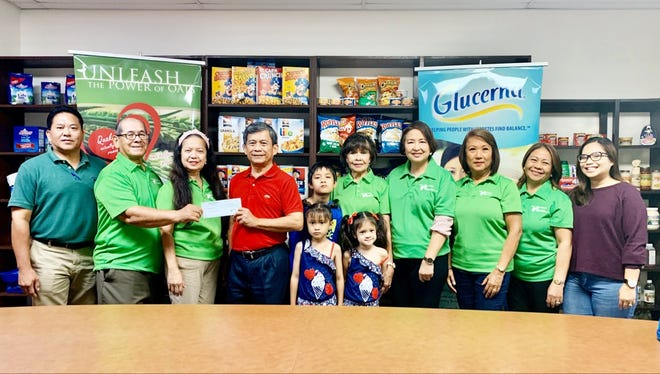 Micronesian Brokers Inc. is a gold sponsor of the 20th annual Guam Diabetes Conference hosted by the Guam Diabetes Association. Pictured from left: Noel Metra, MBI sales manager; Scott Duenas, GDA president; Glynis Almonte, GDA secretary: Hermie Queja, MBI general manager; kids- Brayden Butler, Zoe Butler, Zea Butler; Winnie Butler, GDA executive director; Del Agahan, Linda Simon, GDA auditor;  Nilda Antolin, GDA special projects; and Heidi Almonte, MBI senior marketing brand manager.