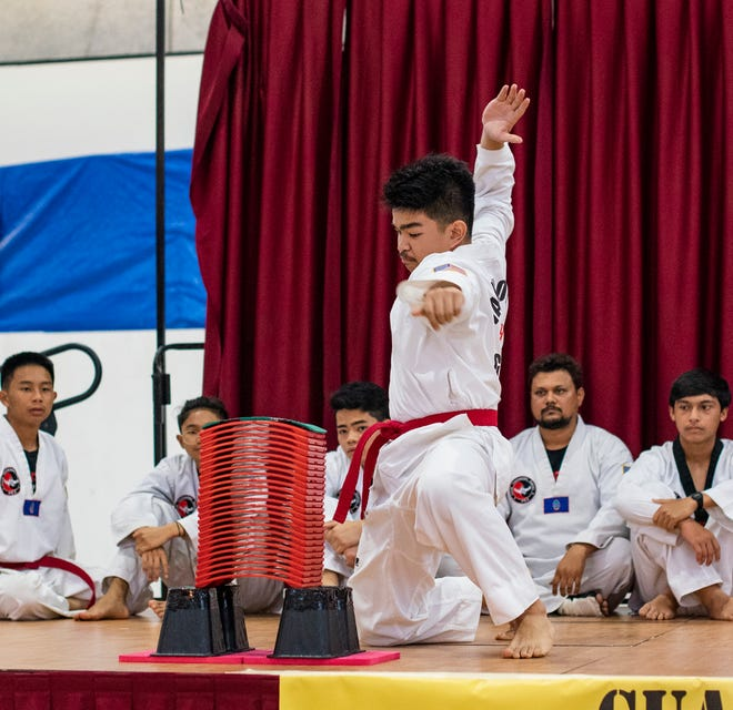 Guam Taekwondo Center red belt Kevin Fernandez shows the form that won him the gold medal at the 2019 5th Master Noly's Tile Breaking Tournament Nov. 9 at the Micronesia Mall.