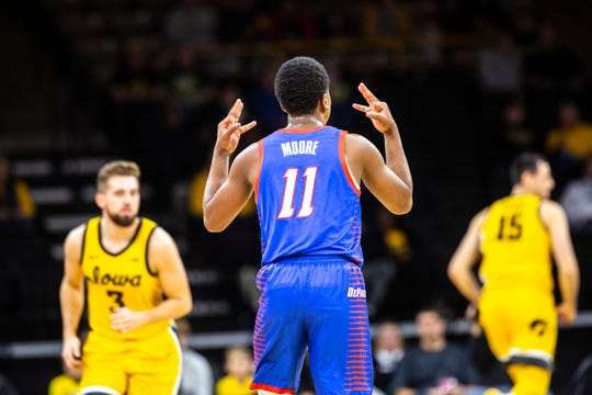This was a familiar sight Monday at Carver-Hawkeye Arena: A DePaul player celebrating a made basket. Here, it's Charlie Moore signaling a successful 3-pointer. The Blue Demons routed the Hawkeyes.