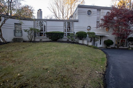The front of this ship-inspired Art Deco home called Windsweep is listed for $575,000 and is located in the gated Brendonwood neighborhood of Indianapolis, near I-465 and East 56th Street, Friday, Nov. 8, 2019.