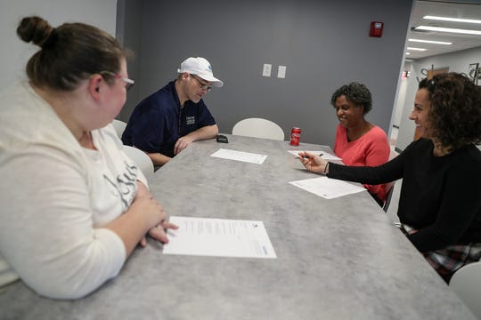 From left, Nicki Hinkle, Shawn Fulton, Melody Cooper and Jessica Kaneft plan the Self-Advocates of Indiana December board meeting, at non-profit The Arc's office in downtown Indianapolis on Thursday, Nov. 7, 2019.