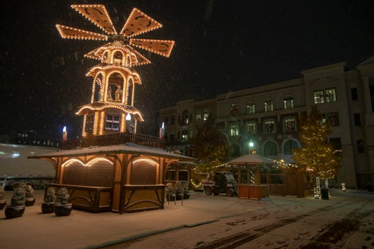 A Fall snow shower blankets the Christkindlmarkt in Carmel, Monday, Nov. 11, 2019. The open air German-inspired village includes gift shopping and ice skating, and opens up on Saturday, Nov. 16, and runs until Christmas Eve.