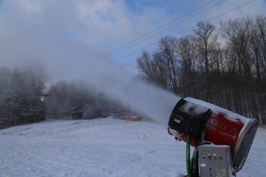 A snow gun at Greek Peak Mountain Resort blasts snow.