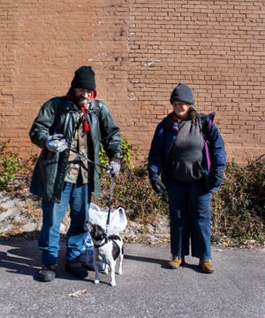 Jack and Lauri Myers and their service dog Memphis are struggled to find shelter during the cold season in Jackson on Tuesday.