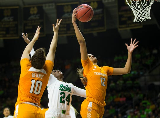 Tennessee's Rae Burrell (12) grabs a rebound as Notre Dame's Destinee Walker (24) fights for it with Tennessee's Jessie Rennie (10) during an NCAA college basketball game Monday, Nov. 11, 2019 at Purcell Pavilion in South Bend, Ind.