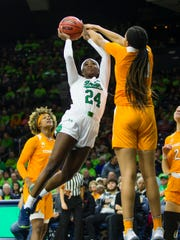 Notre Dame's Destinee Walker (24) gets blocked by Tennessee's Tamari Key (20) during an NCAA college basketball game Monday, Nov. 11, 2019 at Purcell Pavilion in South Bend, Ind.